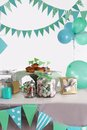 Blue And Green Colored Birthday Party Table Stock Photo - 38414710