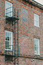 Escape Ladder On Brick Building Royalty Free Stock Photo - 38416825