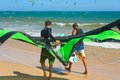 Kitesurfers On The Beach Royalty Free Stock Images - 38417609