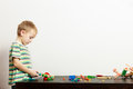 Boy Child Kid Preschooler Playing With Building Blocks Toys Interior Royalty Free Stock Image - 38419276