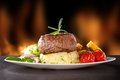 Fresh Beef Steak On Black Stone And Fire Royalty Free Stock Image - 38423576
