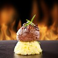 Fresh Beef Steak On Black Stone And Fire Royalty Free Stock Photo - 38424345