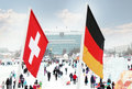 Flag Of Switzerland And Germany On Wind Royalty Free Stock Photography - 38502427