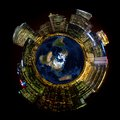 Bright City Lights On Miniature Planet Earth Stock Image - 38503521