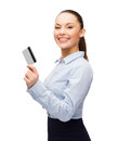 Smiling Businesswoman Showing Credit Card Royalty Free Stock Images - 38519179
