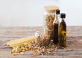 Close Up Of Two Olive Oil Bottles And Pasta In Jar Royalty Free Stock Image - 38526156