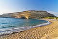 Matala Beach And Big Rock With Small Caves, Island Of Crete Stock Images - 38534614