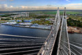 Cable Stayed Bridge Under Construction, And A Berth For Ships. Stock Photos - 38542333