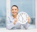Attractive Businesswoman With White Clock Royalty Free Stock Photo - 38571965