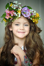 Beautiful Little Girl Wearing A Wreath Of Flowers Royalty Free Stock Photography - 38589977