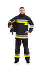 Firefighter Posing With Helmet Under His Arm Stock Photo - 38621890