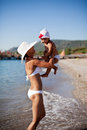 Mother And Her Little Daughter At The Seaside. Stock Photos - 38653373