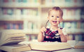 Funny Baby Girl In Glasses Reading A Book Stock Images - 38656184