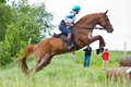 Eventer On Horse Is Jump The Cross-country Fence Royalty Free Stock Photography - 38687617