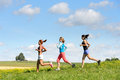 Female Friends Running Downhill Sunny Meadow Stock Images - 38688104