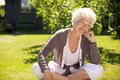 Senior Woman Sitting Outdoors Lost In Thoughts Royalty Free Stock Images - 38688189
