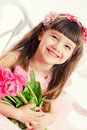 Adorable Little Girl With Bouquet Of Tulips Stock Photography - 38711112