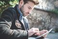 Young Handsome Fashion Model Using Tablet Man Stock Photography - 38724592
