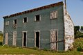 Old Granary Lacks Doors And Window Coverings Royalty Free Stock Images - 38757439
