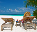 Woman At Beach With Chaise-lounges Stock Images - 38761734