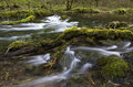Lathkill River With Mossy Boulders And Branches Stock Images - 38763004