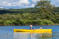 Calm River And Woman Relaxing In A Kayak Stock Images - 38788644