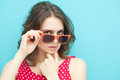 Girl In Sunglasses On A Blue Background Stock Images - 38803204