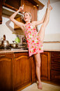 Young Athletic, Flexible, Pin-up Woman Blonde Girl At The Stove Tastes Soup With Scoop Or Ladle Royalty Free Stock Images - 38816449