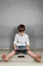 Boy Playing On Tablet Royalty Free Stock Image - 38836746