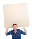 Man Holding Up Blank Poster Sign Stock Photography - 38886882