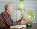 Old Man With Globe Stock Photos - 38894113