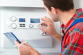 Technician Servicing Heating Boiler Royalty Free Stock Photography - 38894917