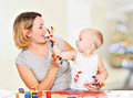 Happy Child Draws On The Face Of His Mother. Stock Image - 38896451