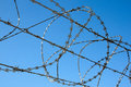 Close Up Of Razor Security Fence Against Blue Sky Stock Images - 38897244