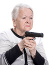 Old Woman With Pistol Royalty Free Stock Photos - 38903248