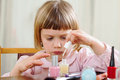 Three Year Old Girl Making Manicure Stock Photo - 38916910