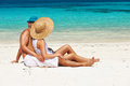 Couple In White Relax On A Beach At Maldives Stock Photos - 38949183