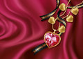 Necklace Heart On Red Silk. Royalty Free Stock Photography - 38955347