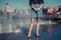 Young Woman Standing By Fountain In City Stock Photo - 38973110