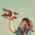 Happy Child Playing With Toy Airplane Stock Image - 38989721