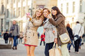 Three Girlfriends Indicating Something Interesting Royalty Free Stock Photography - 38998717