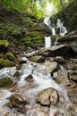 Waterfall In Mountains Stock Images - 39014634