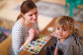 Mother And Little Son Playing Together Education Card Game For C Royalty Free Stock Image - 39026786