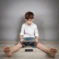Boy Playing On Tablet Stock Photo - 39038800