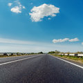 Asphalt Road To Horizon Under Blue Sky Royalty Free Stock Photos - 39059568