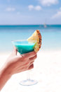 Blue Curacao Cocktail In Female Hand Stock Photography - 39064662