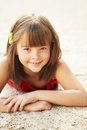 Girl Lying On The Sand Royalty Free Stock Photo - 39066065