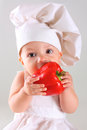 Little Baby In A Cap Chef With Pepper Royalty Free Stock Image - 39078936