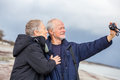 Elderly Couple Taking A Self Portrait Stock Images - 39083434