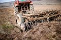 Vintage Tractor Plowing The Field Stock Images - 39090424